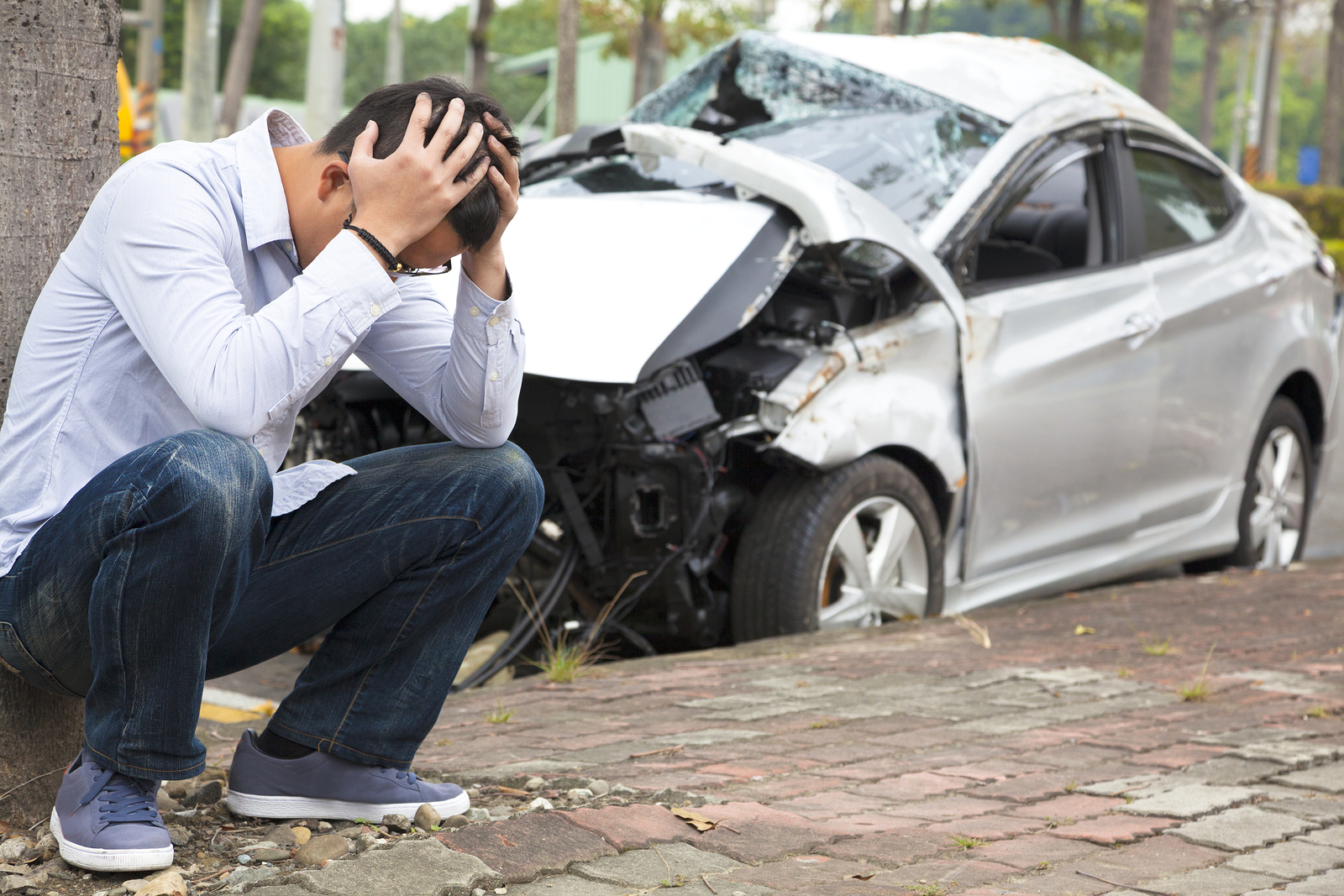 man holding his head after being in an auto accident injury